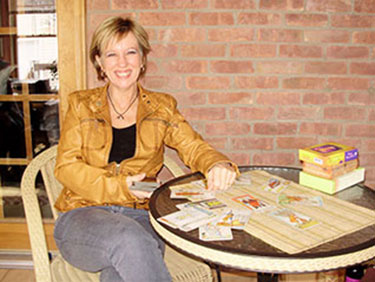 Picture of Sandy at table with Tarot cards